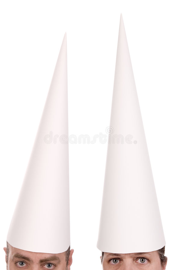 Dunce cap on man and woman royalty free stock images