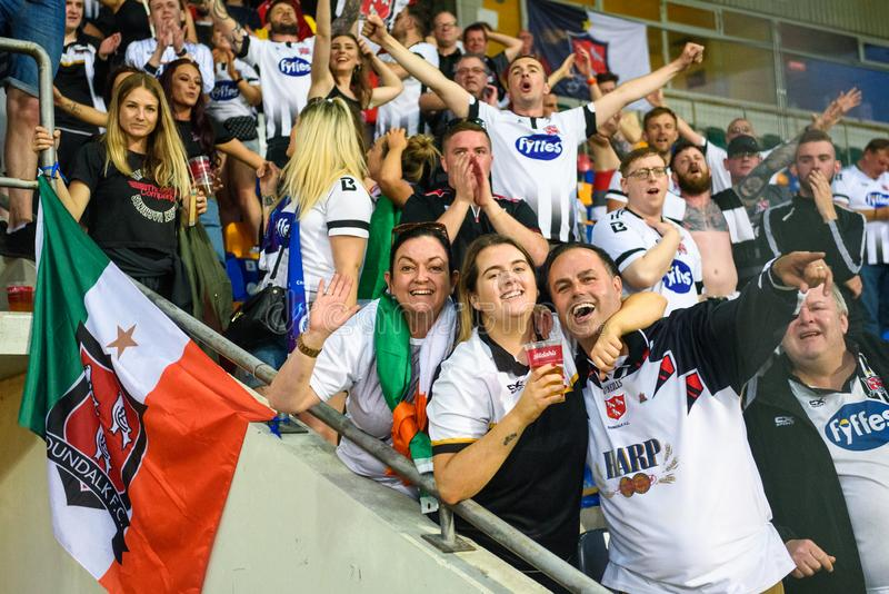 DUNDALK FC fans celebrated after their team win at penalties,. RIGA, LATVIA. 17th of July, 2019. DUNDALK FC fans celebrated after their team win at penalties royalty free stock photos