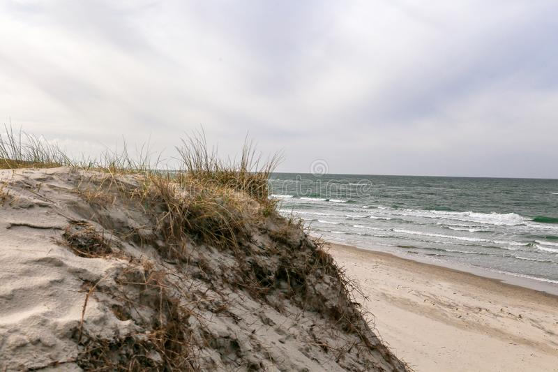 Dune at the Baltic Sea, Grass sand dune beach sea view. With clouds stock photography