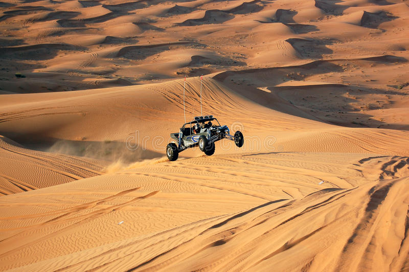 Dune bashing with a dune buggy. A high speed dune buggy dune bashing in Dubai, UAE stock images