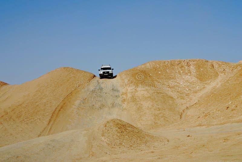 Dune bashing, Sahara Desert, Tozeur, Tunisia. Dune bashing is a popular tourist activity as part of safaris in the Sahara Desert near Tozeur, Tunisia stock photos