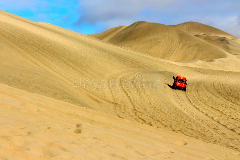 Dune Buggy. A high speed dune buggy dune bashing in Huacachina Peru stock photo