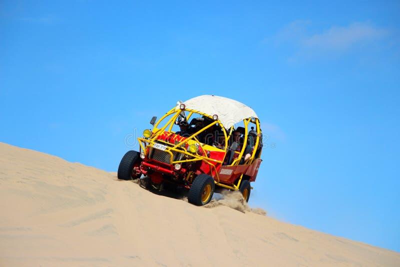 Dune Buggy. A high speed dune buggy dune bashing in Huacachina Peru stock photography