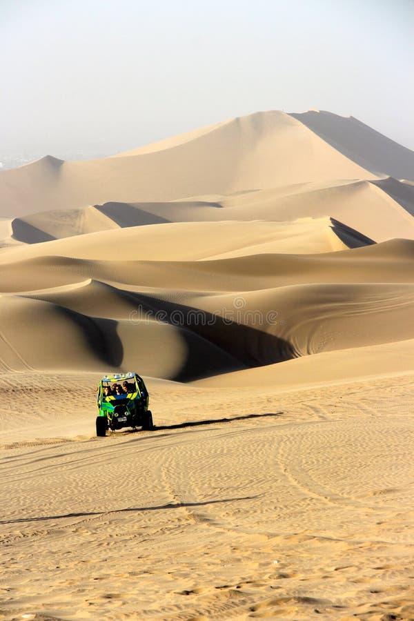 Dune Buggy. A high speed dune buggy dune bashing in Huacachina Peru stock photos