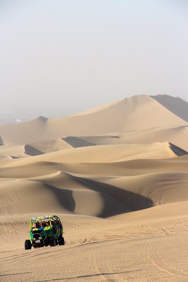 Dune Buggy. A high speed dune buggy dune bashing in Huacachina Peru royalty free stock photos