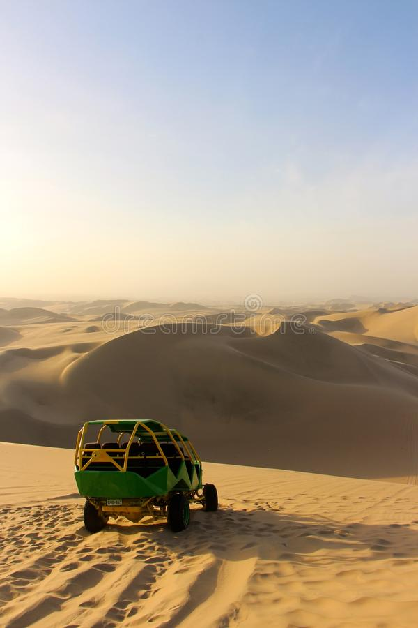 Dune Buggy. A high speed dune buggy dune bashing in Huacachina Peru royalty free stock photo