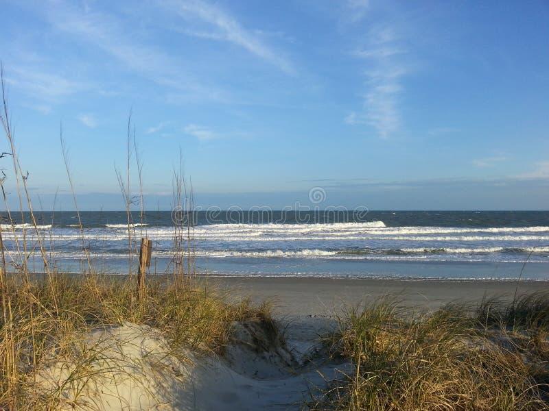 Dune Draped Sandy Ocean Front stock photo
