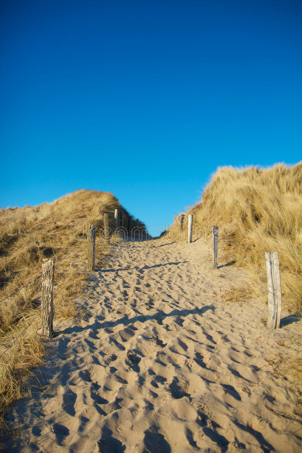 Dune Pathway 1. Sandy pathway between dunes leading towards the North Sea on Sylt island, Germany royalty free stock images