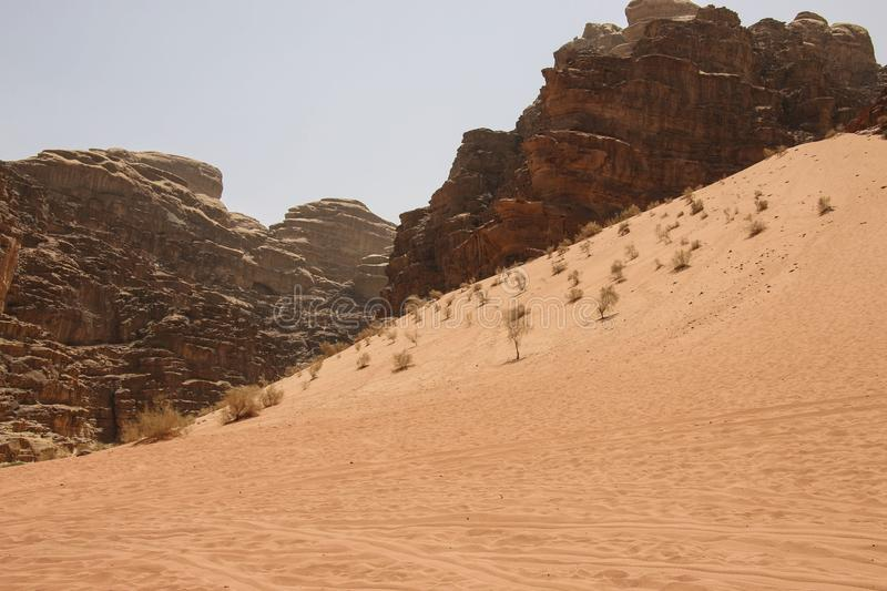Dune and red mountains of the canyon of Wadi Rum desert in Jordan. Wadi Rum also known as The Valley of the Moon in southern stock image