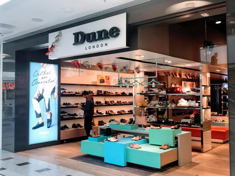 Dune store. The Dune Group is one of the most influential global players in fashion footwear and accessories. Based in London, the fashion capital of the world stock image