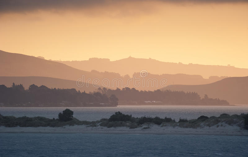 dunedin λίμνη νέα πέρα από το ηλιοβασίλεμα Ζηλανδία στοκ εικόνα με δικαίωμα ελεύθερης χρήσης