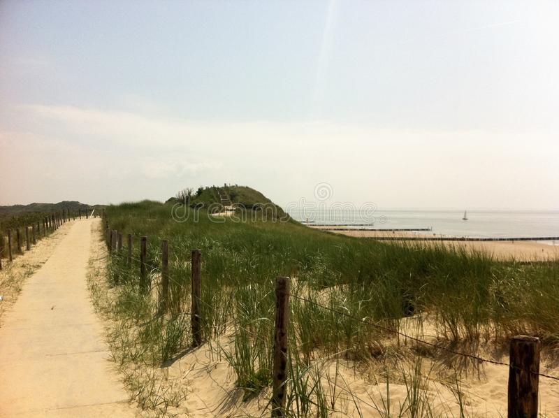 Dunes behind the beach royalty free stock photo