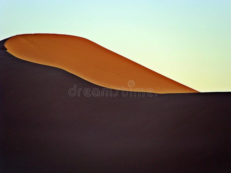 Dunes in the moroccan sahara desert. M`Hamid is a town that is in the Zagora region, in the center of Morocco, and is recognized as one of the places where the stock images
