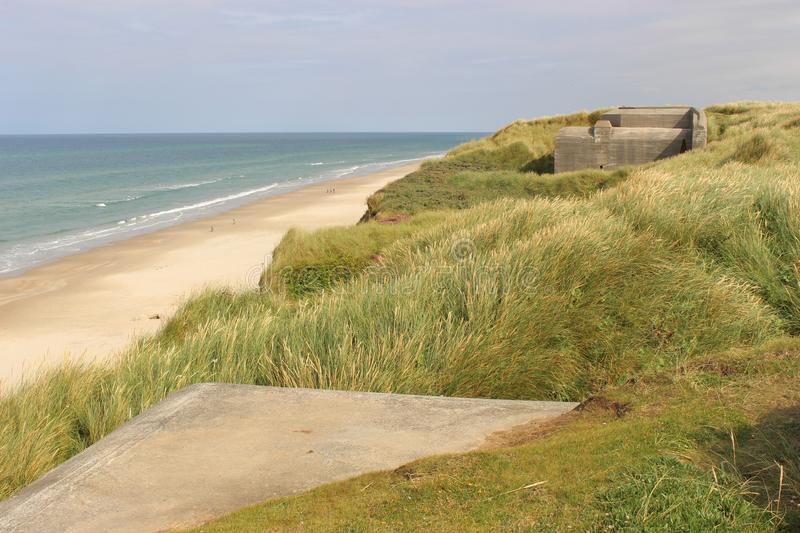 On the dunes near Lokken, Denmark, Europe. On the dunes near Lokken, Denmark, by the North Sea. One can see ruins of bunkers from the Second World War, built by stock photo