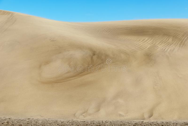 Dunes with sand whirl. Sand whirl at the dunes of Maspalomas on Grand Canary, Spain stock photos