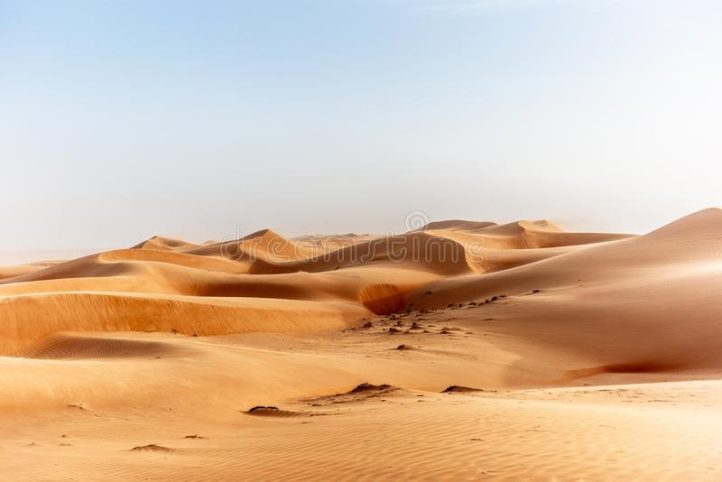 The dunes of the Wahiba Sands desert in Oman at sunset during a. Typical summer sand storm - 18 stock photo