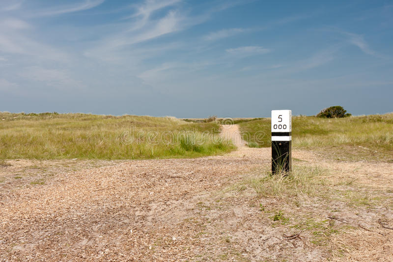 Dunes With Wooden Distance Marker Royalty Free Stock Images