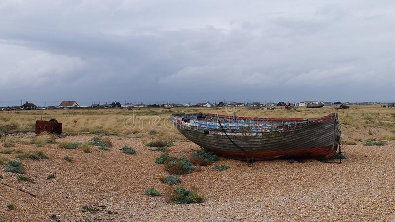 Old Boat in Dungeness in Southern England. Dungeness is one of the biggest shingle beaches in Europe and has attracted many artists over the years because of its stock images