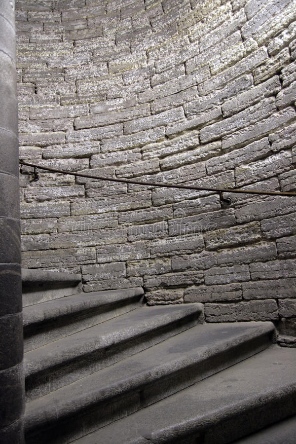Dungeon with spiral staircase stock images