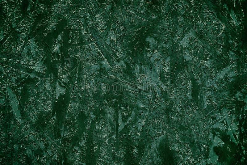 Dunkelgrüner abstrakter Hintergrund von gepressten Holzspänen lizenzfreie stockfotos