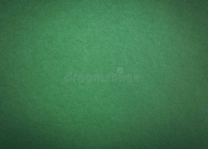 Dunkelgrüner Papierhintergrund lizenzfreie stockfotos