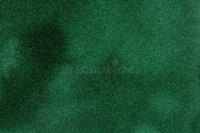 Dunkelgrünes Samtpapier für Hintergrund für Ihr einzigartiges Projekt stockbild