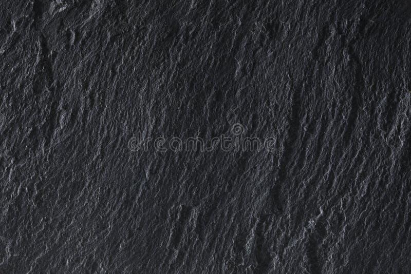Dunkelgraue Schieferhintergrundbeschaffenheit mit Kopienraum für Ihren Text stockfotos