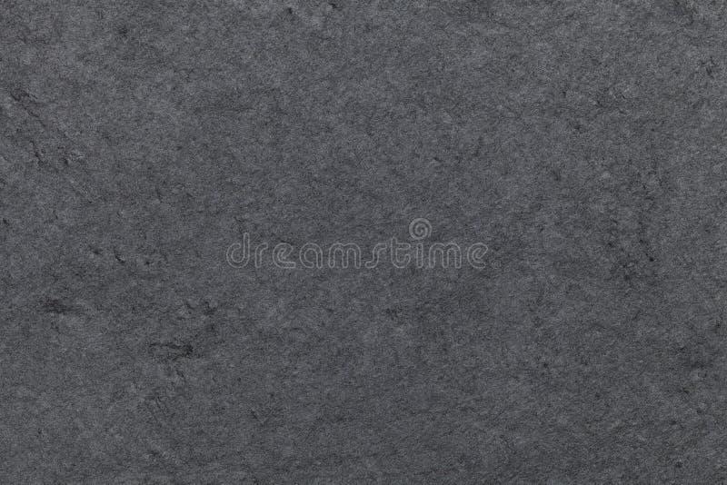 Dunkelgrauer Hintergrund des Naturschiefers Beschaffenheitsschwarze Steinnahaufnahme lizenzfreie stockfotografie