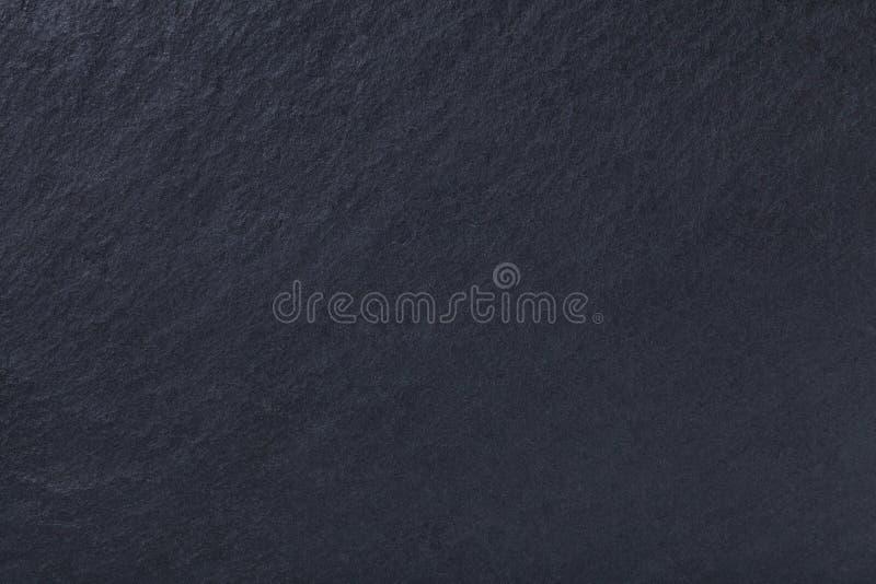 Dunkelgrauer Hintergrund des Naturschiefers Schwarzer Stein der Beschaffenheit lizenzfreies stockfoto