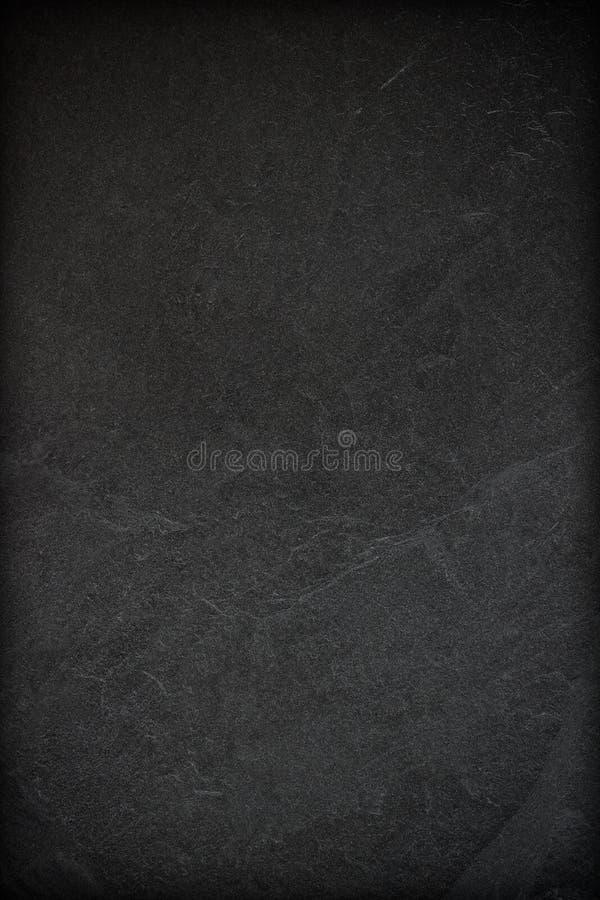 Dunkelgrauer schwarzer Schieferhintergrund oder -beschaffenheit stockfotografie