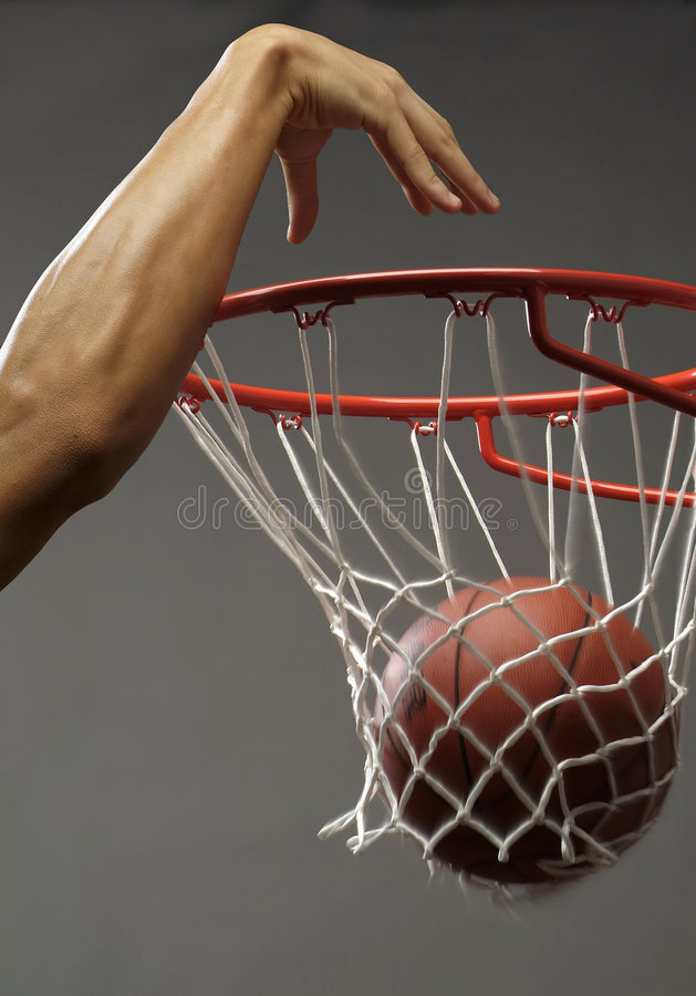 Free Dunking A Basketball Royalty Free Stock Image - 6071926