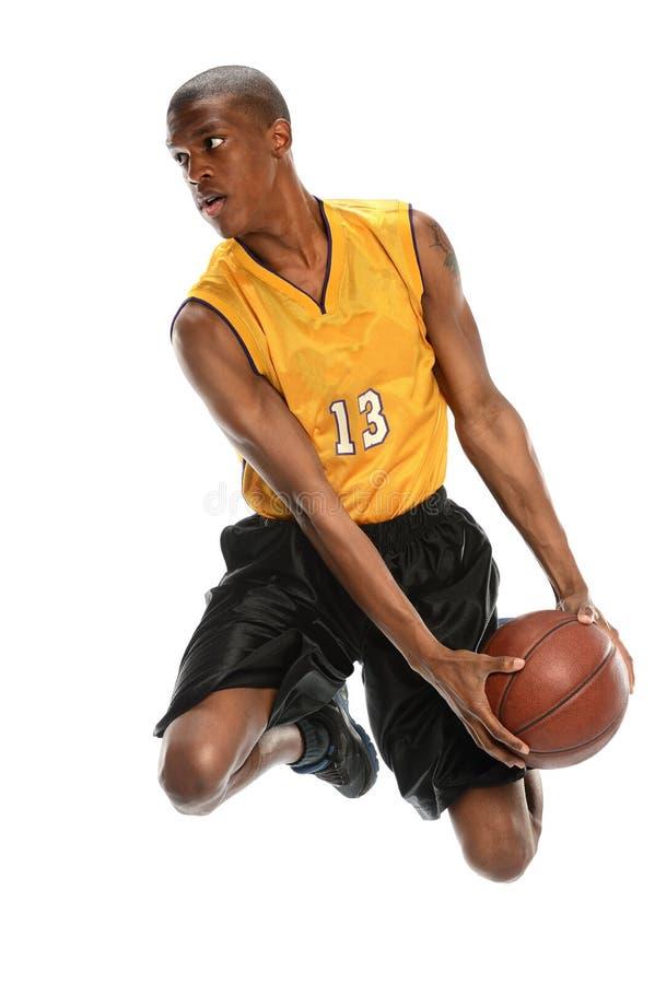 Dunking novo do jogador de basquetebol imagem de stock royalty free
