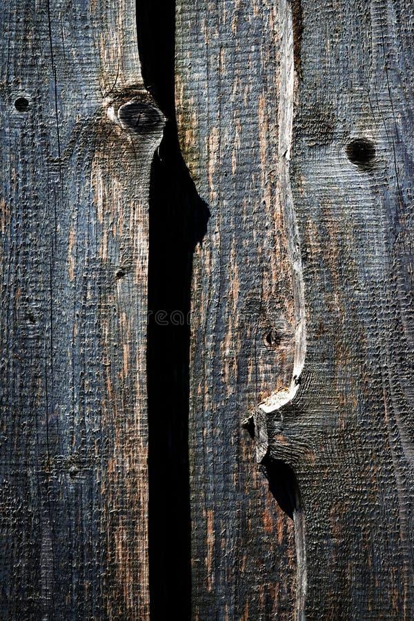 Dunkle alte hölzerne Bretter mit Schatten lizenzfreie stockbilder