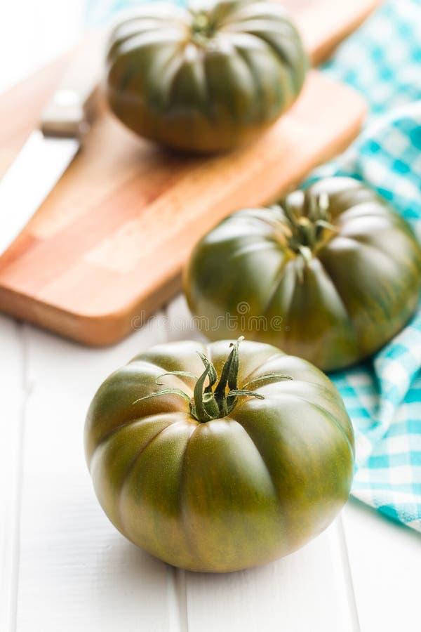 Dunkle brandywine Tomaten stockfotos