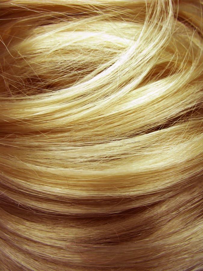 Dunkler Beschaffenheitshintergrund des blonden Haares lizenzfreies stockfoto