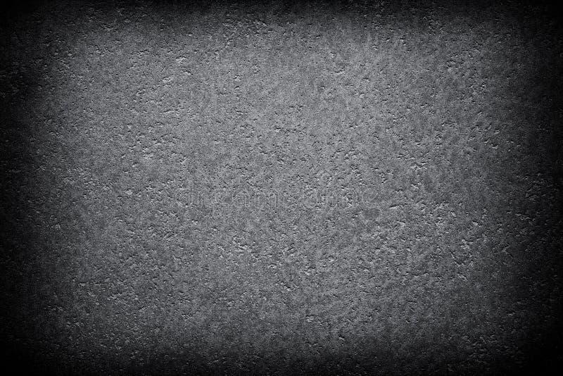 Dunkler Schmutzschwarzzusammenfassungsbeschaffenheits-Vignettenhintergrund stockfoto