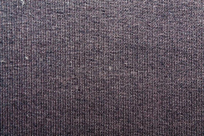 Dunkler violetter Hintergrund von einem Textilmaterial mit Weidennahaufnahme Struktur des Marineblaugewebes mit natürlicher Besch lizenzfreie stockfotografie