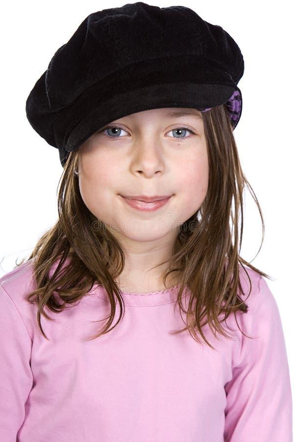 Dunkles behaartes Mädchen, das an der Kamera lächelt lizenzfreies stockfoto