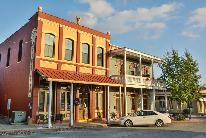 Dunlap byggnader som daterar från 1870, i Brenham, TX royaltyfri foto