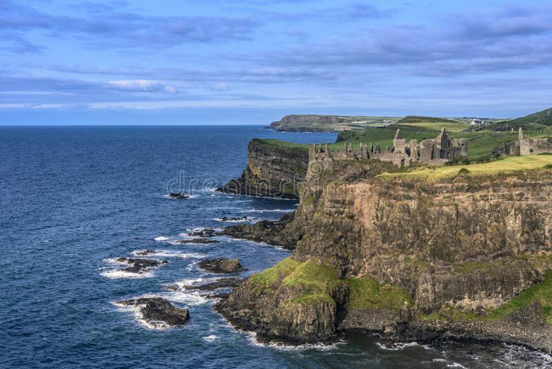 Dunluce Castle located on the edge of a basalt outcropping, Count Antrim, Northern Ireland royalty free stock photo