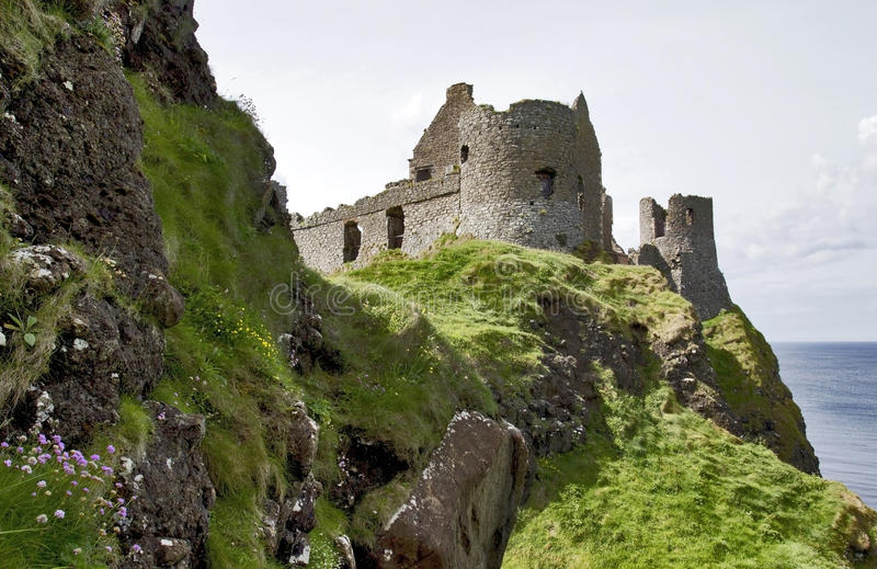 Dunluce Castle North Antrim Coast, Northern Ireland. Dunluce Castle built on a headland that drops straight into the sea along the North Antrim coast. The castle royalty free stock images