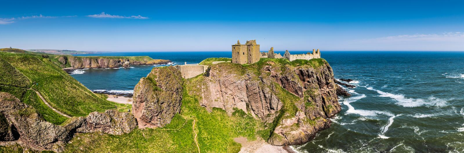 Dunnottar Castle on a calm sunny day royalty free stock photo