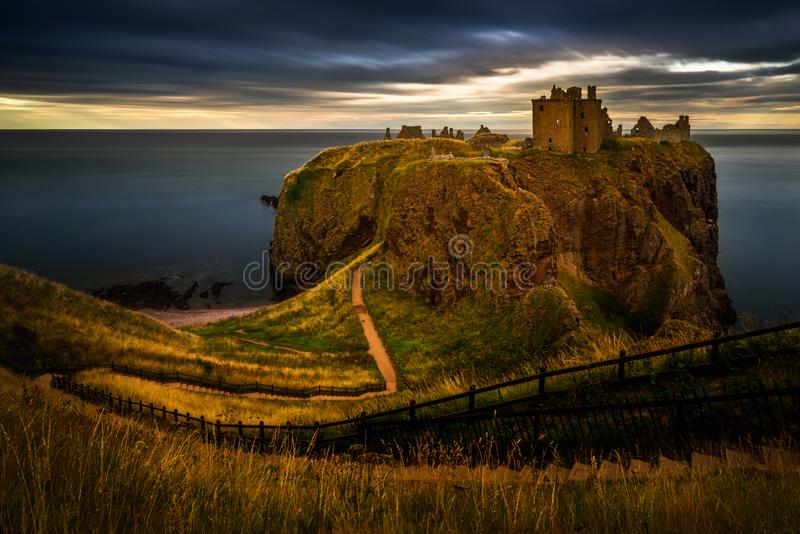 Dunnottar Castle sunset. Dunnottar Castle on high cliffs in sunset light, Scotland royalty free stock image