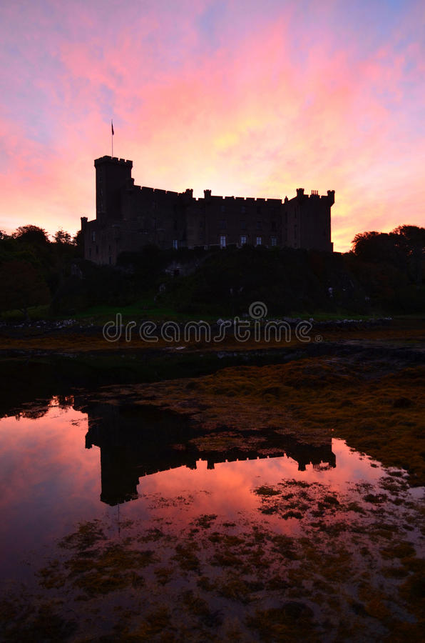 Dunvegan Castle Reflecting in the Loch at Sunrise stock photo