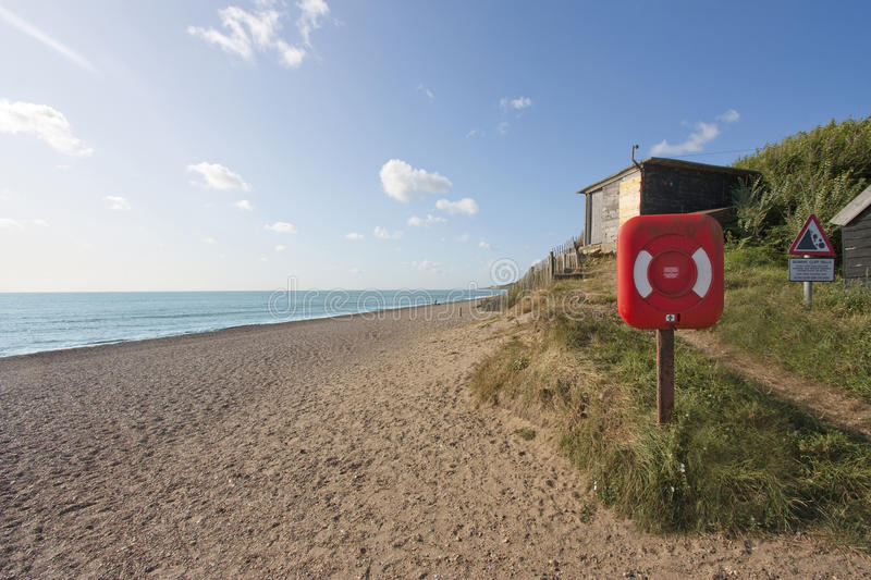 Dunwich beach. In summer, with red lifebelt royalty free stock image