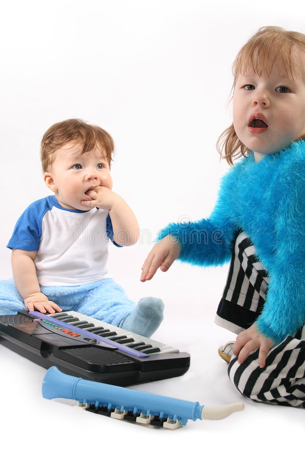 Duo. Small boy and Girl plays with the electronic piano stock image