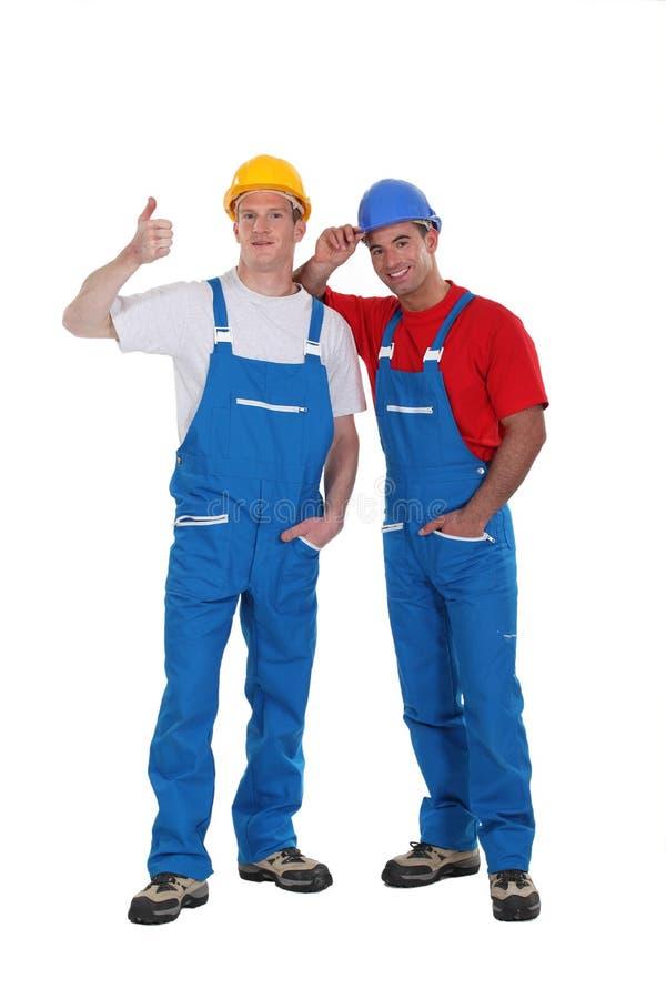Duo de construction images libres de droits