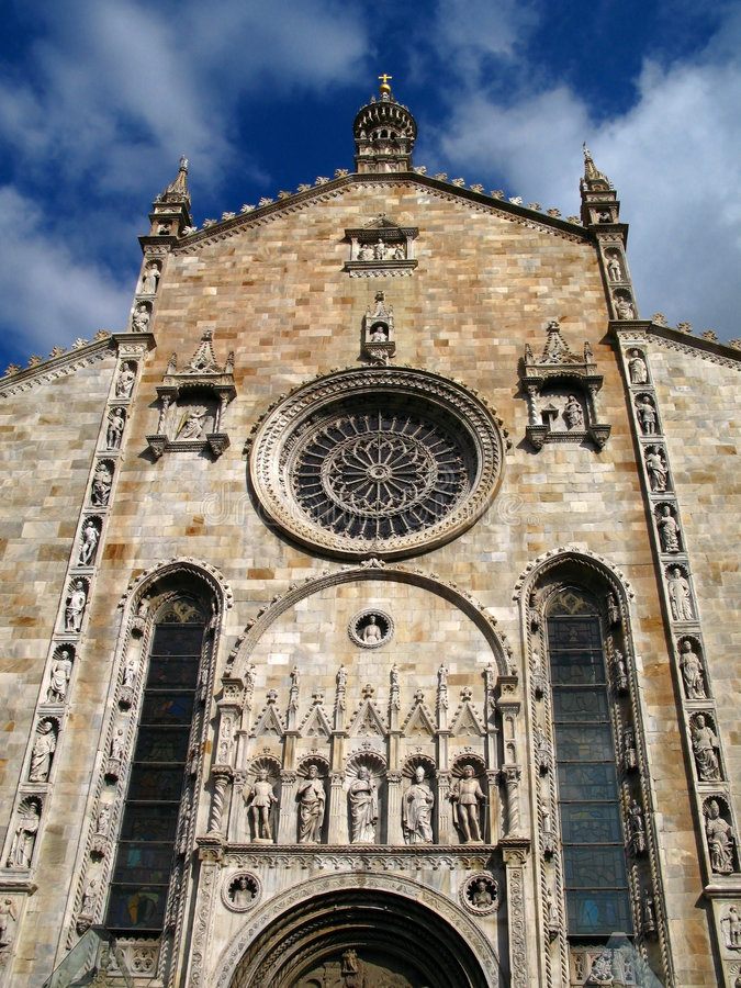 Duomo Cathedral, Como, Italy. The Como Cathedral (Duomo) was build between 1396 and 1740. This front facade in particular was finished in 1457 by the famous stock image