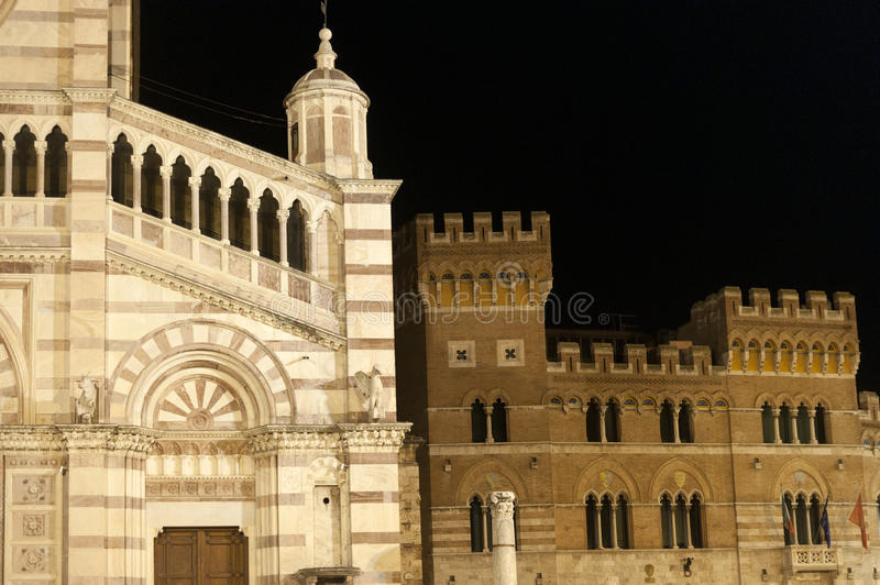 Duomo di Grosseto and palace. Grosseto (Tuscany, Italy), cathedral facade and historic palace by night royalty free stock photography