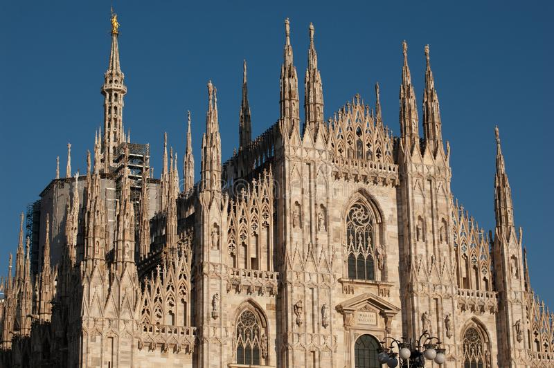 Duomo di Milano. People in front of facade of italian gothic church in the centre of Milan, Italy. Festival or. Duomo di Milano. People in front of facade of royalty free stock image